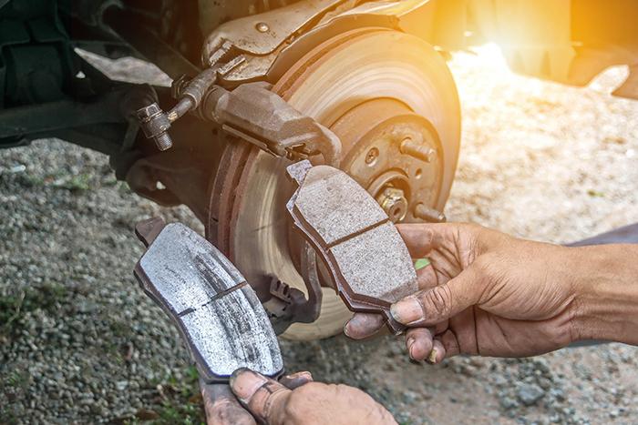 Man comparing Brake Pads